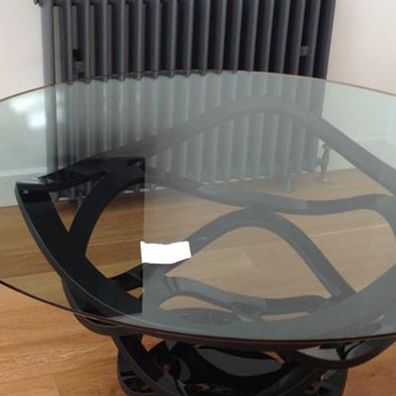 A glass table ready to be moved