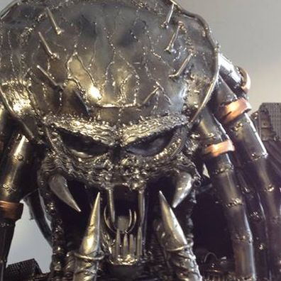 The head of a metal Predator statue that our team moved