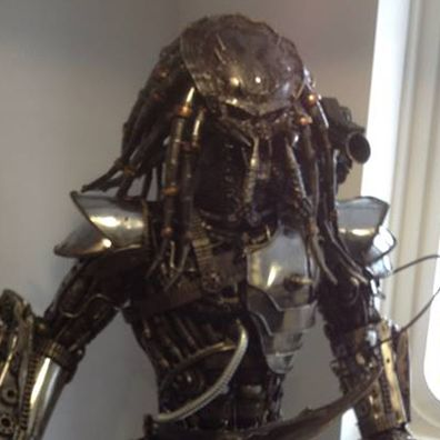 Predator statue that our team is getting ready to move